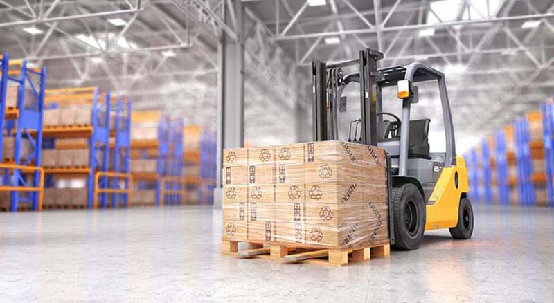 Close up of warehouse and forklift with load of boxes on palette